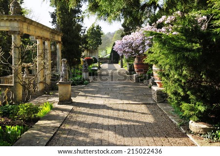 Stone Pebble Garden Pathway in a Beautiful Formal Garden  - stock photo
