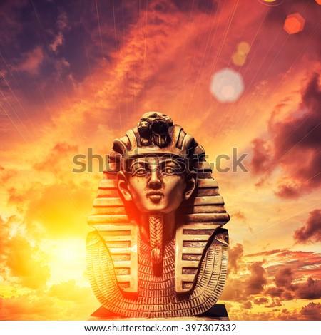Stone pharaoh tutankhamen mask on sky background - stock photo