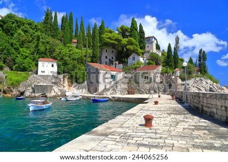 Stone pier of a small harbor near the Adriatic sea, Trsteno, Croatia - stock photo