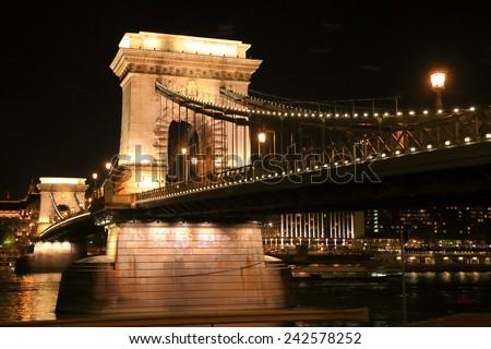 Stone pillars of the Chain bridge illuminated by night, Budapest, Hungary - stock photo