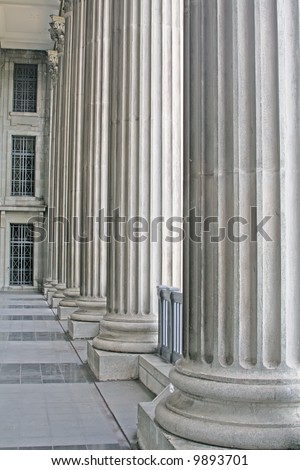 Stone Pillars Outside a Court during the day