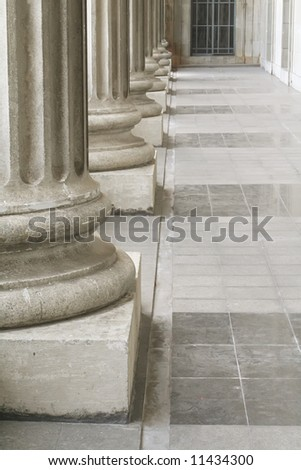 Stone Pillars outside the Parliament during the Day - stock photo