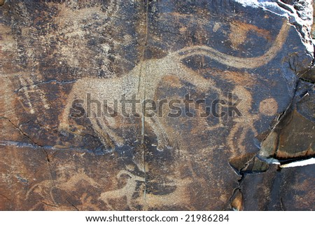 Stone plate with ancient drawings - stock photo