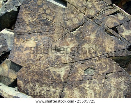 Stone plate with the ancient images. Area Tamgaly. - stock photo