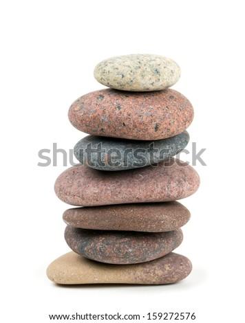 stone pyramid isolated on white - stock photo