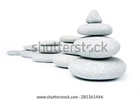 Stone pyramid over white - stock photo