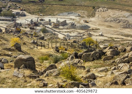 Stone quarry work under an mountain - stock photo