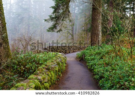 Stone railing on the South Loop Trail, part of the Trail of Ten Falls at Silver Falls State Park in Oregon. - stock photo