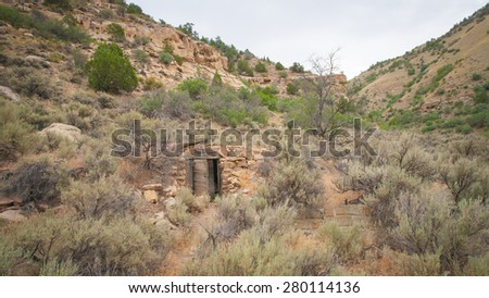 Stone remains of old homestead built by Mormon settlers in Utah wilderness. - stock photo