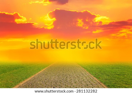 Stone road going to sunlight  - stock photo