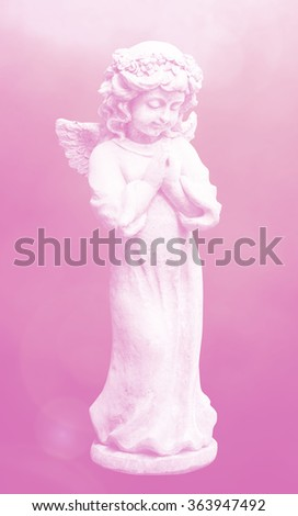 Stone Sculpture of a little girl holding a bird in her hand, selective focus, for garden decoration - stock photo