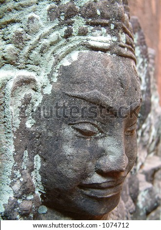stone sculpture of face in Cambodian Temple - stock photo
