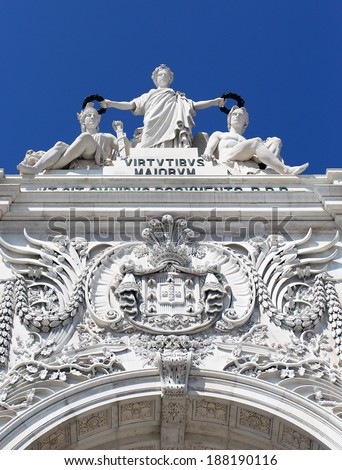 Stone sculptures standing on the historical arch in the center of Lisbon - stock photo