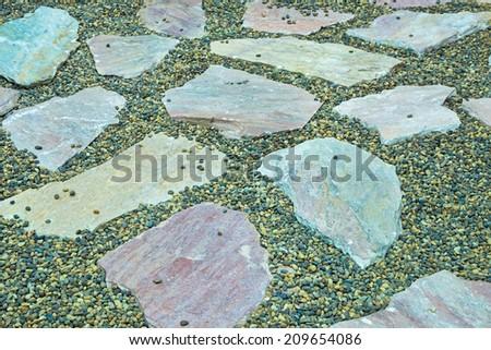 Stone slabs walkway lined gravel many. - stock photo