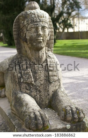 Stone sphinx in a botanical garden - stock photo