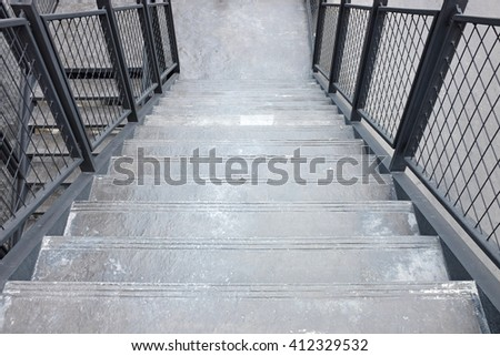 Stone stair with railing of stair at department store - stock photo
