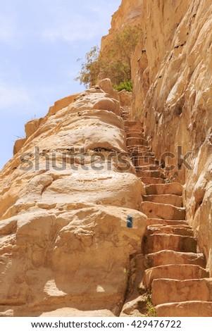 Stone staircase in rock - stock photo