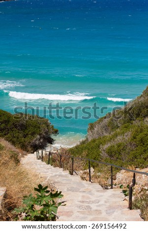 stone staircase in the cliffs leading to the sea - stock photo
