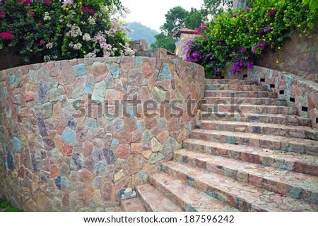 Stone staircase, up and down, textured background,Natural stone stairs landscaping in home garden. - stock photo