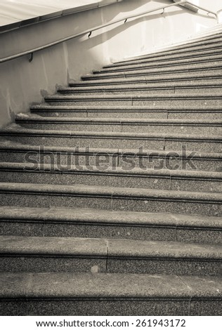 Stone staircase with iron railing. Toned. - stock photo