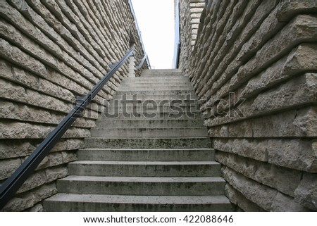 Stone staircase with railing - stock photo