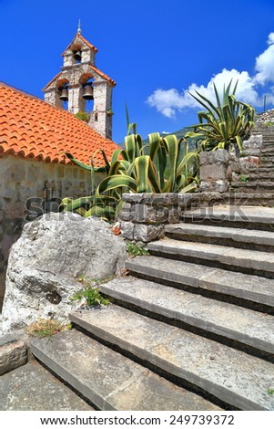 Stone stairs ascending above orthodox church from the Adriatic sea region, Montenegro - stock photo