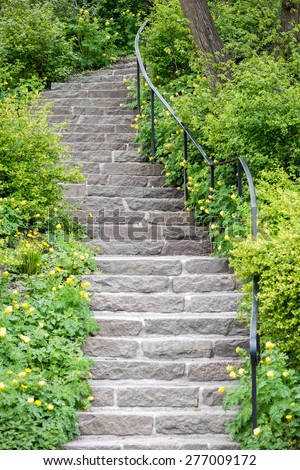 Stone stairs at a green garden during spring, Sweden - stock photo