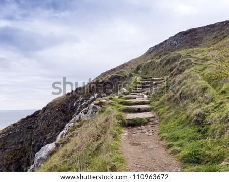 Stone stairs on the way round the coast, Ireland - stock photo