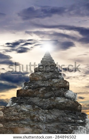 Stone stairs to the light. - stock photo