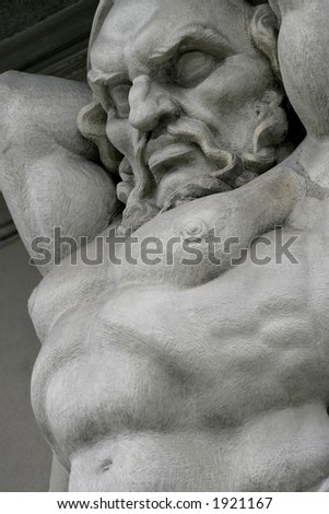 Stone statue in Zurich, Switzerland.  Focus is on the face. - stock photo