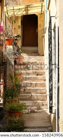 Stone steps to doorway in a small French town.