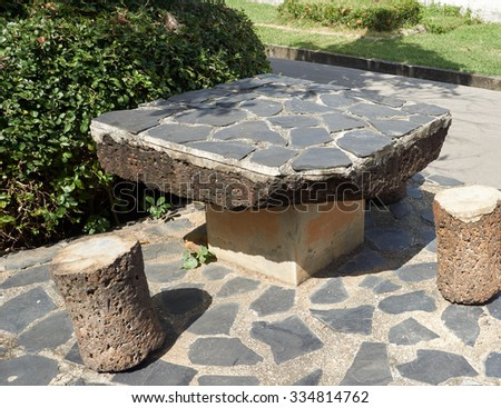 Stone table place in garden under sunlight - stock photo
