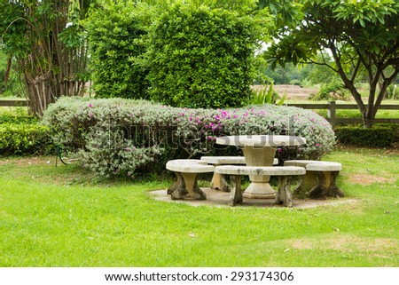 Stone Table Set in Landscaped Garden