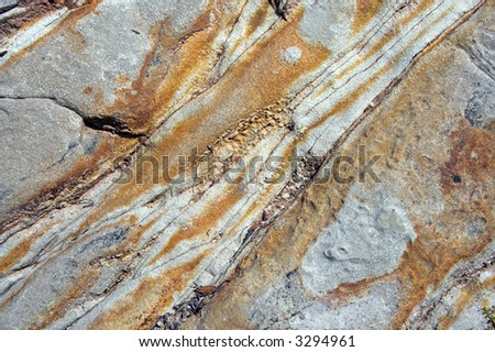 Stone texture made of orange and yellow traces - stock photo