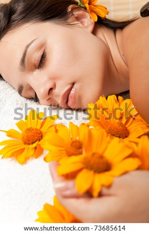 Stone therapy. Woman getting a hot stone massage at spa salon - stock photo
