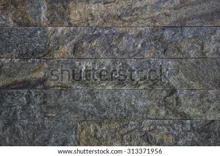 Stone tile wall texture background. - stock photo