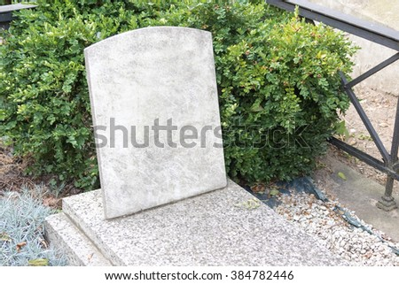 Stone tombstone with the inscription - stock photo