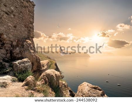 Stone tower on a mountain near sea - stock photo