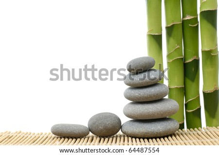 Stone tower with bamboo grove on bamboo stick straw mat - stock photo