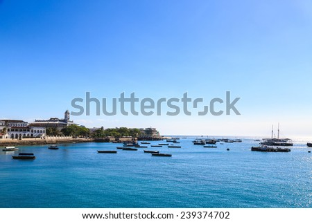 Stone town Zanzibar seen from the water on a sunny day - stock photo
