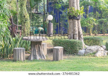 stone tree chairs set in the garden