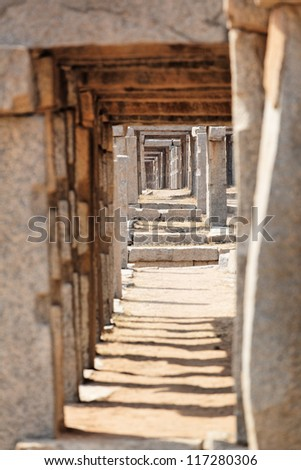 Stone walkway at the temple in Hampi, Karnataka, India - stock photo