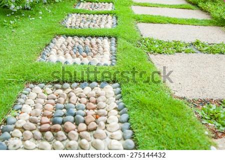 Stone walkway in garden - stock photo