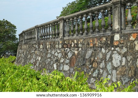 Stone Wall And Concrete Fence