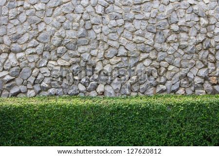 Stone wall and decorative garden - stock photo