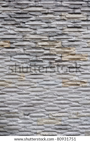 Stone wall background (decorated in garden) - stock photo