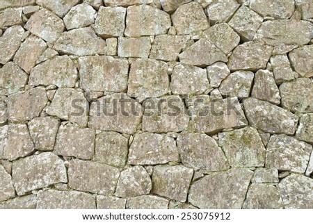 Stone wall background texture pattern - stock photo