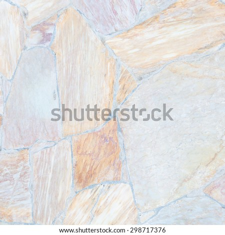 Stone Wall background.They stacked the stones of various sizes into the wall. - stock photo