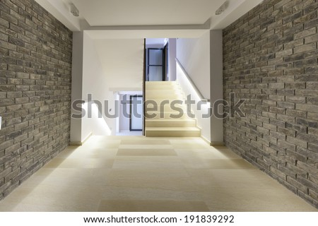 Stone wall corridor with staircase - stock photo