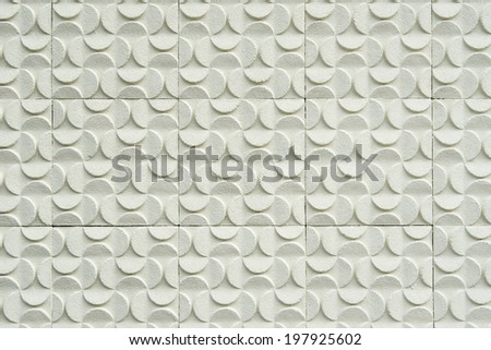 Stone wall from small pieces in white color - stock photo